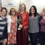 Crestview Elementary staff holding trophy for highest MGP