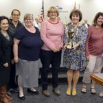 Cottonwood Elementary staff holding trophy for highest MGP