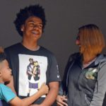 Kearns student smiling with family