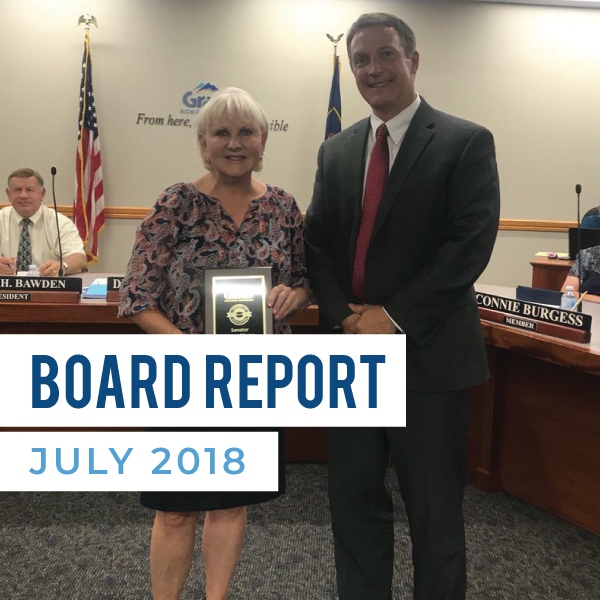 Legislator stands with Granite superintendent and text 'Board Report July 2018'
