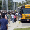 Granger High students boarding bus