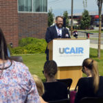 UCAIR representative speaks at podium