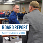 Archer Birrell shakes hands with board members - text: Board Report | September 2018
