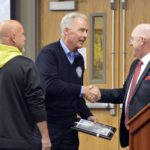 Armstrong Academy custodian shakes hands with Brent Severe
