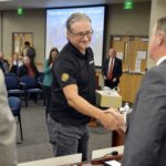 Discover employee shakes hands with Superintendent Bates