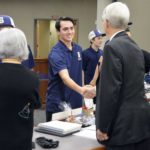Skyline High golf team shakes hands with board members
