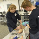 GTI students working with EMT mannequins