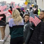 Granite students wave flags in support of Officer Romrell