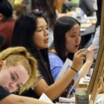 Students painting during Art Olympics