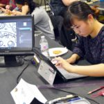 Student drawing on computer during Art Olympics