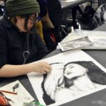 Students drawing during Art Olympics