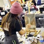 Student painting during Art Olympics