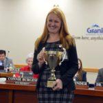 Oakridge Elementary principal holding MGP cup