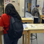 Granite Connection student peruses artwork