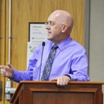 Brent Severe speaks during board meeting