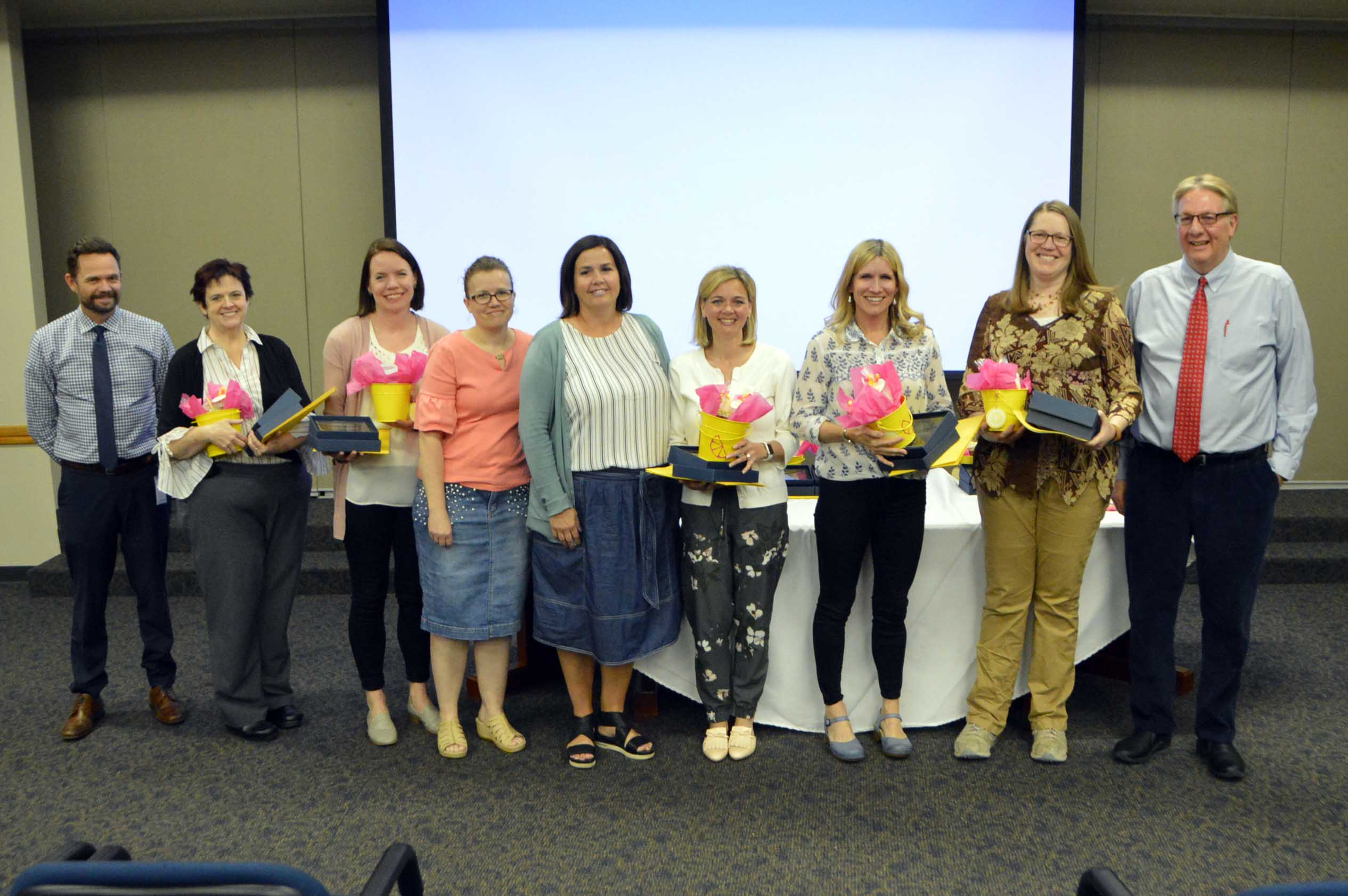 Region 5 PTA awardees stand with plaques