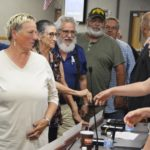 Crossing guards shake hands with board members