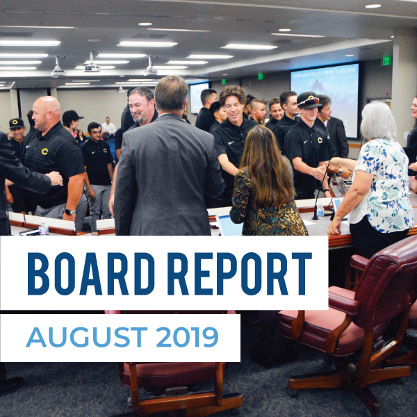 Cottonwood High students greet board members and text 'Board Report August 2019'