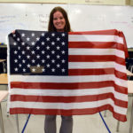 Skyline High teacher holds U.S. Flag in classroom