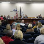 Board members discuss topic at board meeting