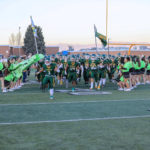Kearns High football team enters the field