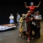Granite student performers act out a scene of a play