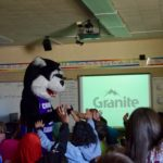 Gang Free mascot gives high fives to students