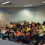 Students cheer during gang prevention presention
