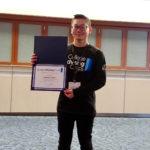 Sambat Kim holding award
