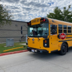 School bus with front crossing arm deployed