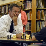 Photo of Superintendent Bates playing chess with a student