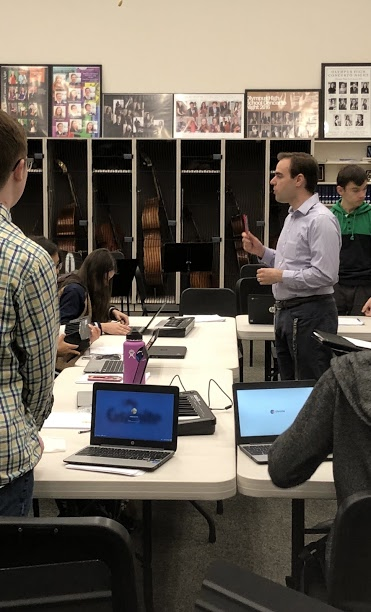 Mr. McMurray in his instrumental music classroom at Olympus High School